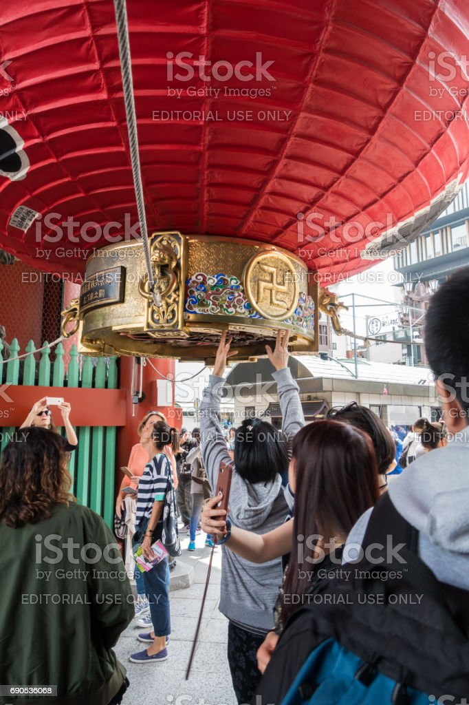 Tourists are touching the Red lanthern in Sensoji Shrine. stock photo
