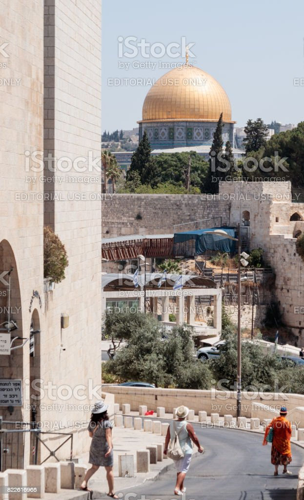 Tourists are walking along the Ma'ale HaShalom Street in the direction of the Al-Aqsa Mosque in the Old City of Jerusalem, Israel stock photo
