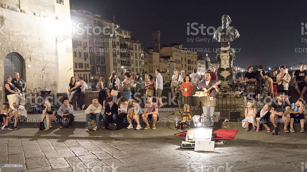 Tourists are watching street performer stock photo
