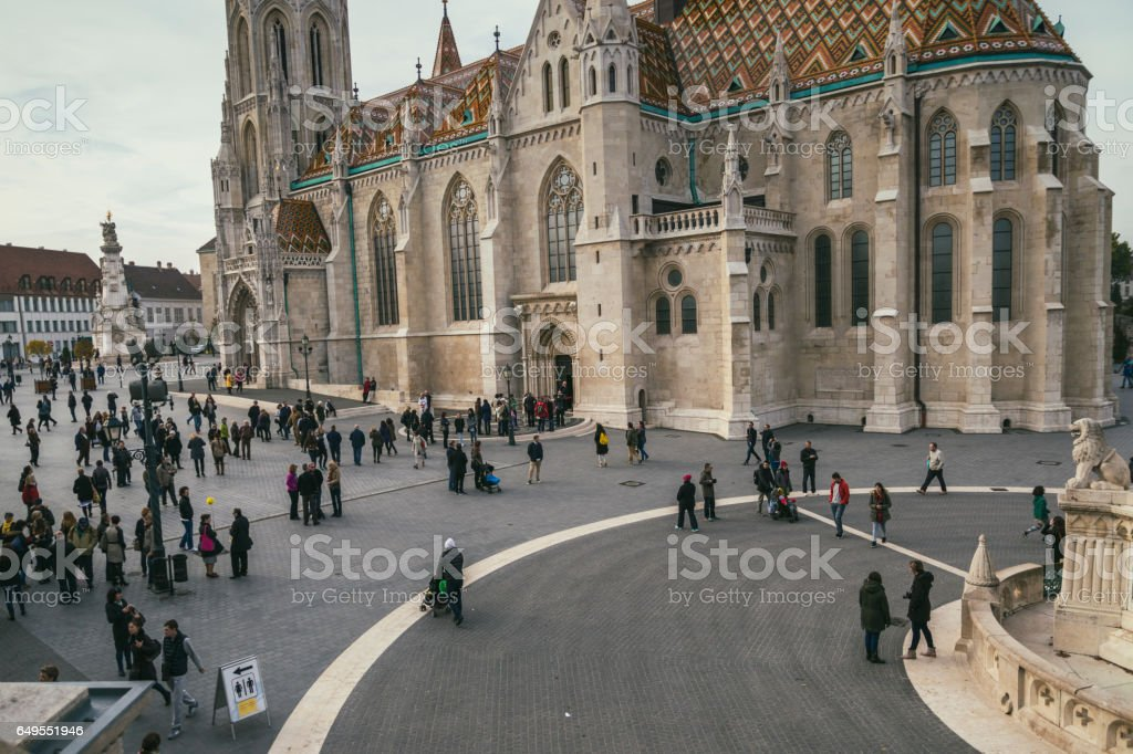 Tourists around Matthias church, in Budapest, who are visiting the Buda Castle District stock photo