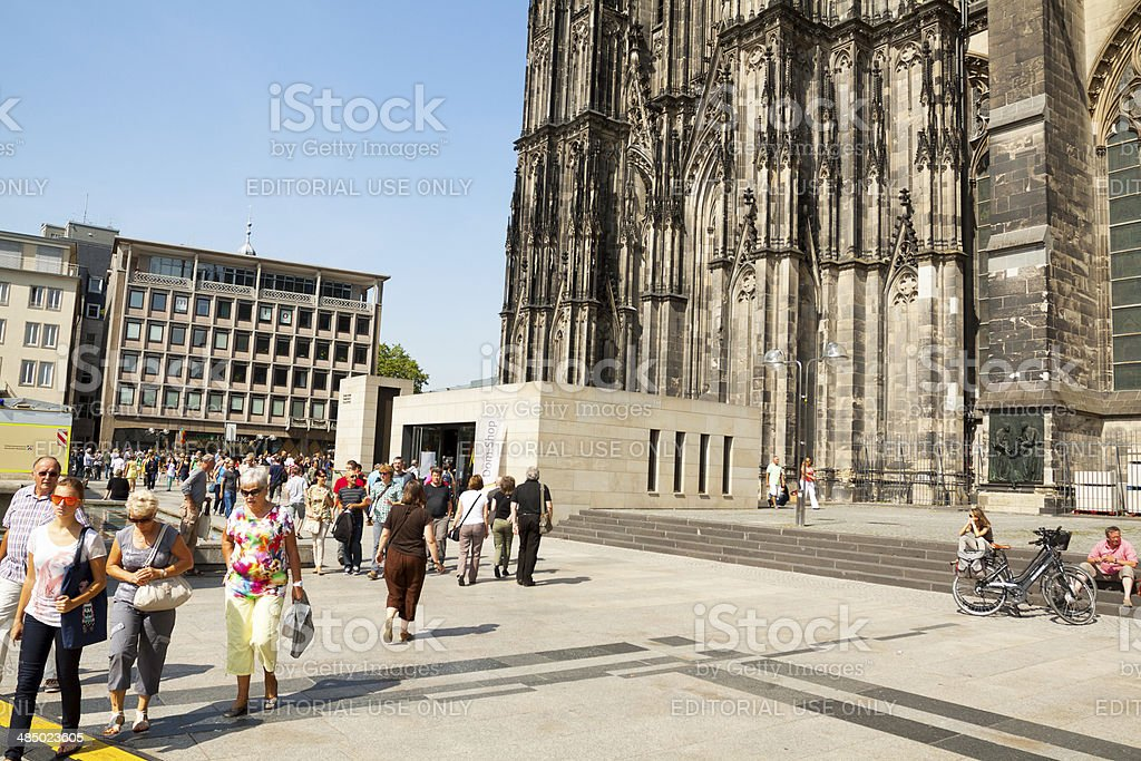 Tourists at cathedral of Cologne royalty-free stock photo