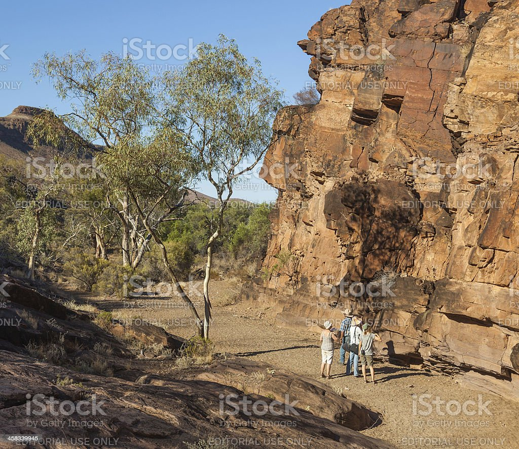 Tourists at Chambers Gorge aboriginal engraving site. Flinders Ranges. Australia stock photo