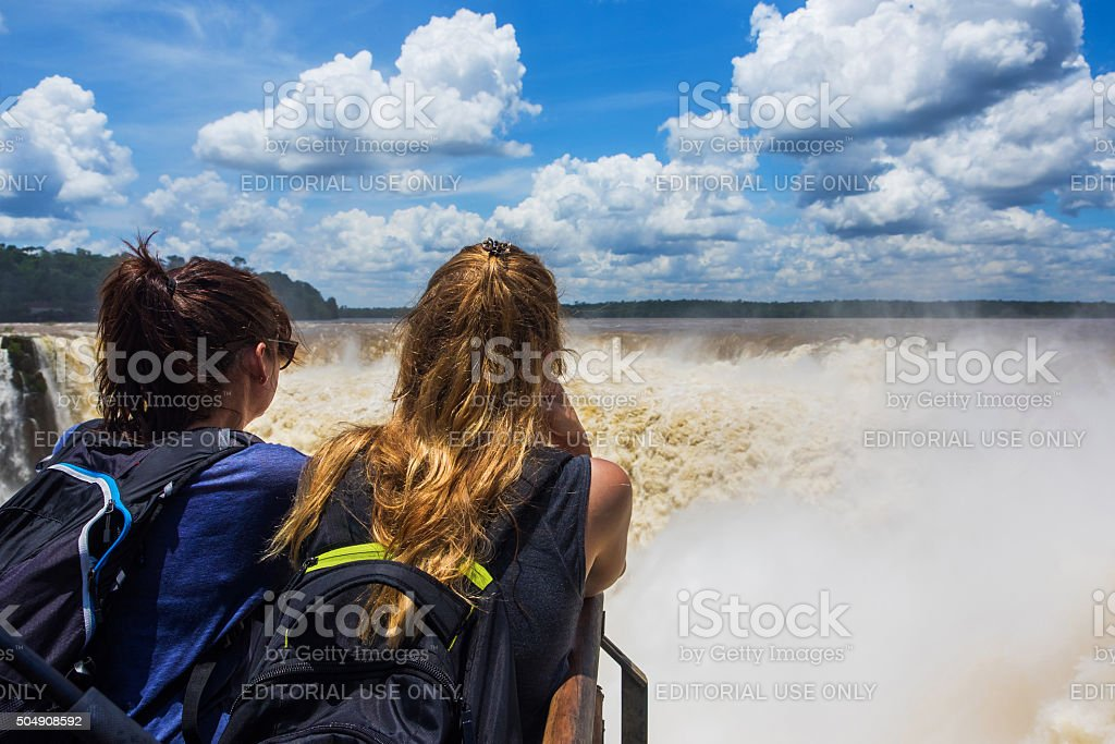 Tourists at Devil's Throat, Iguazu Falls, Argentina stock photo