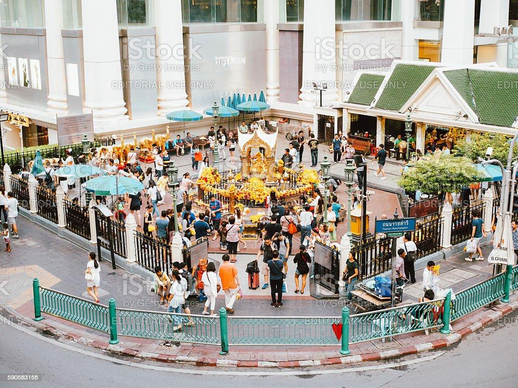 Tourists at Erawan Shrine at Ratchaprasong Intersection stock photo