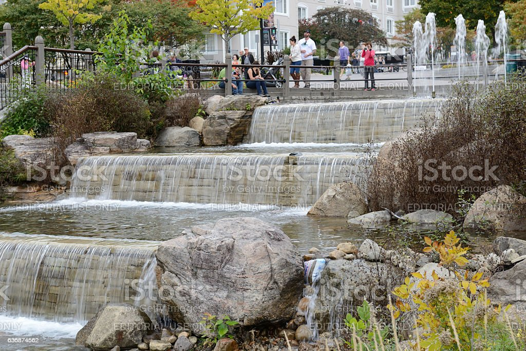 Tourists at fountain in Mont Tremblant Resort Village stock photo