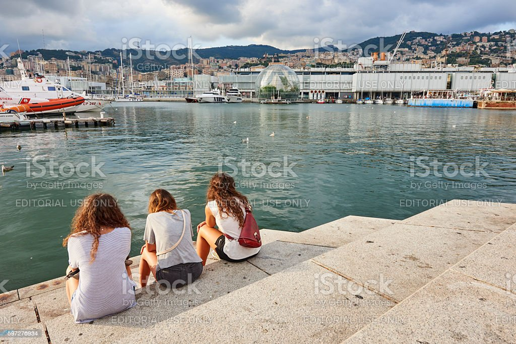 Tourists at Genoa Old Port stock photo