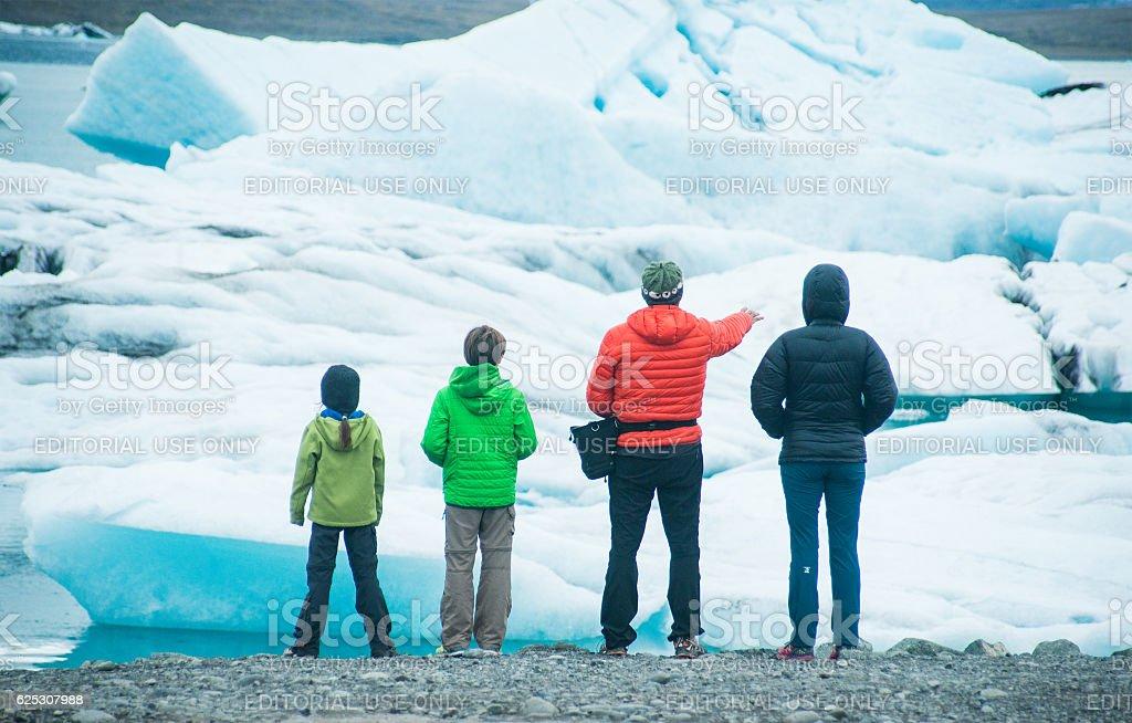 tourists at Jökulsárlón glacier lake in iceland stock photo