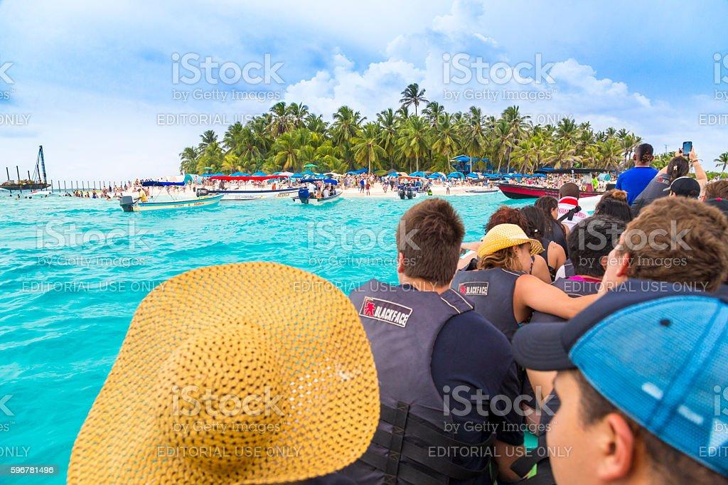 Tourists at Johnny Cay island stock photo