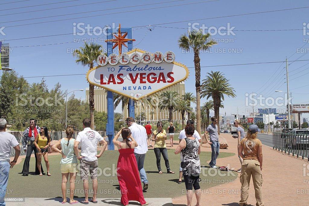 Tourists at Las Vegas sign royalty-free stock photo