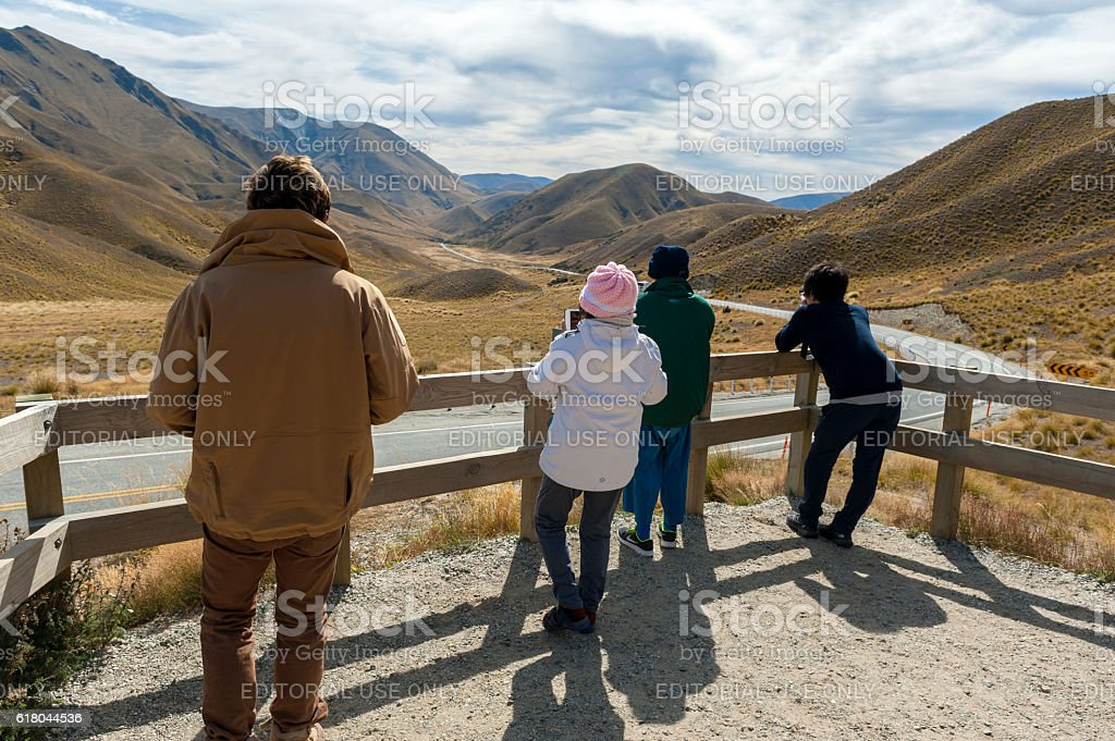 Tourists at Lindis Pass on State Highway 8, New Zealand stock photo