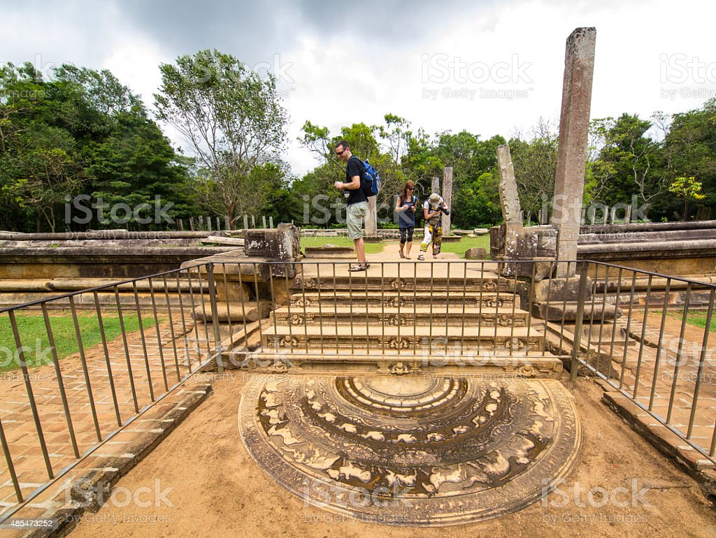 Tourists at moonstone on Ruins site at Anuradhapura, Sri Lanka stock photo