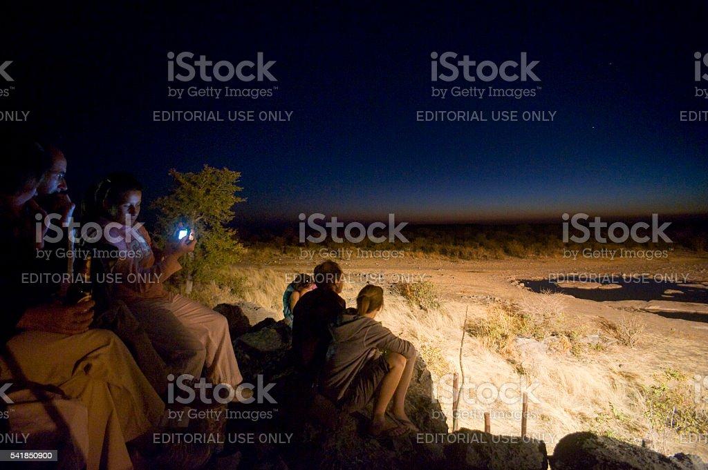 Tourists at Moringa waterhole, Halali Resort, Etosha National Park stock photo