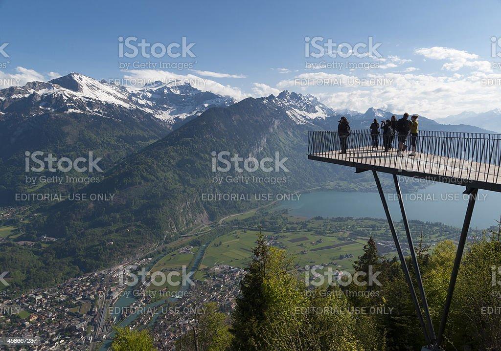 Tourists at mountain viewpoint jetty of Harder Kulm, Interlaken stock photo