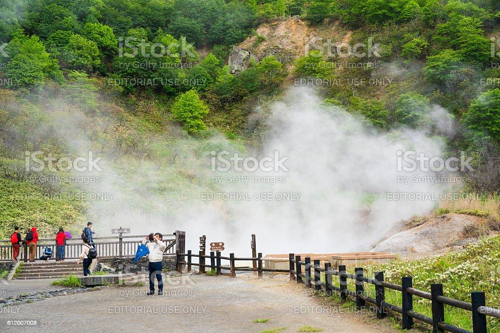 Tourists at Oyunuma lake in Noboribetsu, on Hokkaido, Japan stock photo