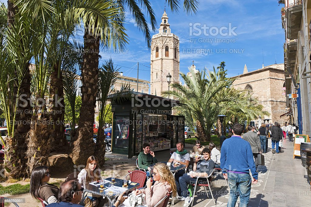 Tourists at pavement cafe palm trees El Micalet Valencia Spain stock photo