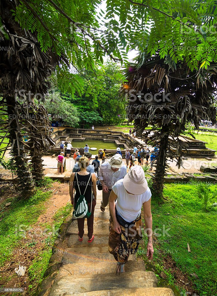 Tourists at Polonnaruwa Ancient royal bathing pool, Sri Lanka stock photo