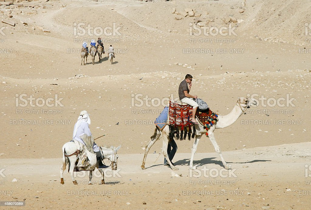 Tourists at Pyramids of Giza in Cairo, Egypt royalty-free stock photo