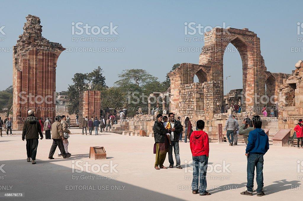 Tourists at Qutb Minar column, New Delhi, India stock photo