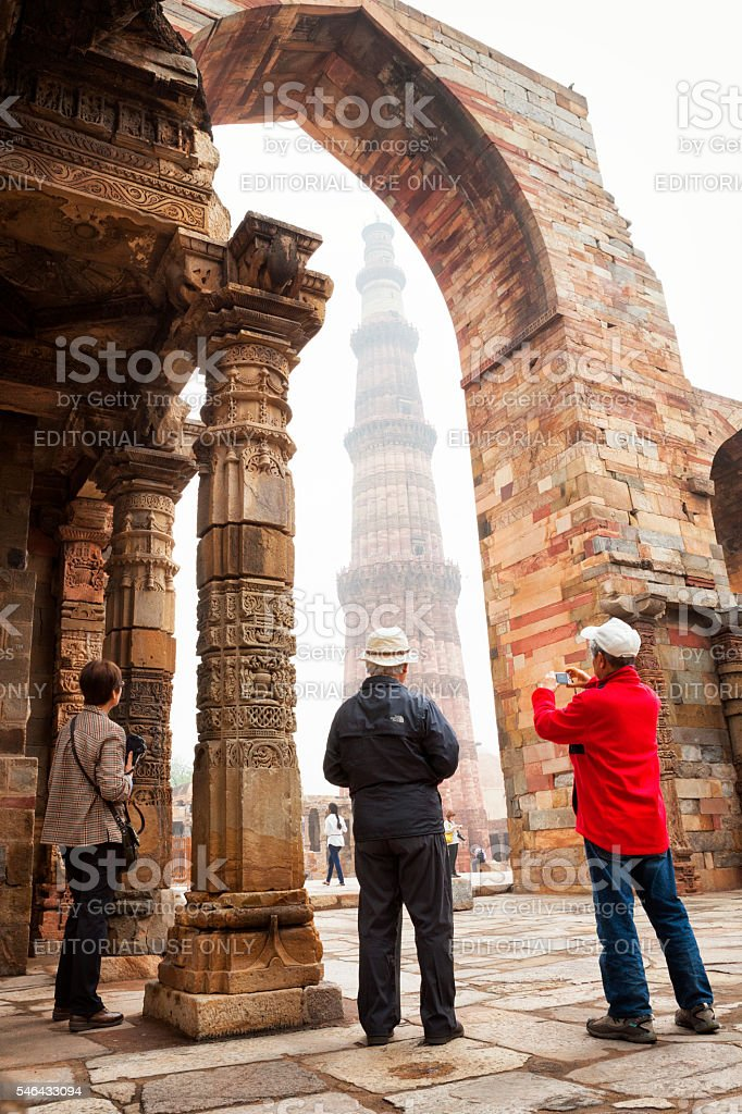 Tourists at Qutb Minar in New Delhi, India. stock photo