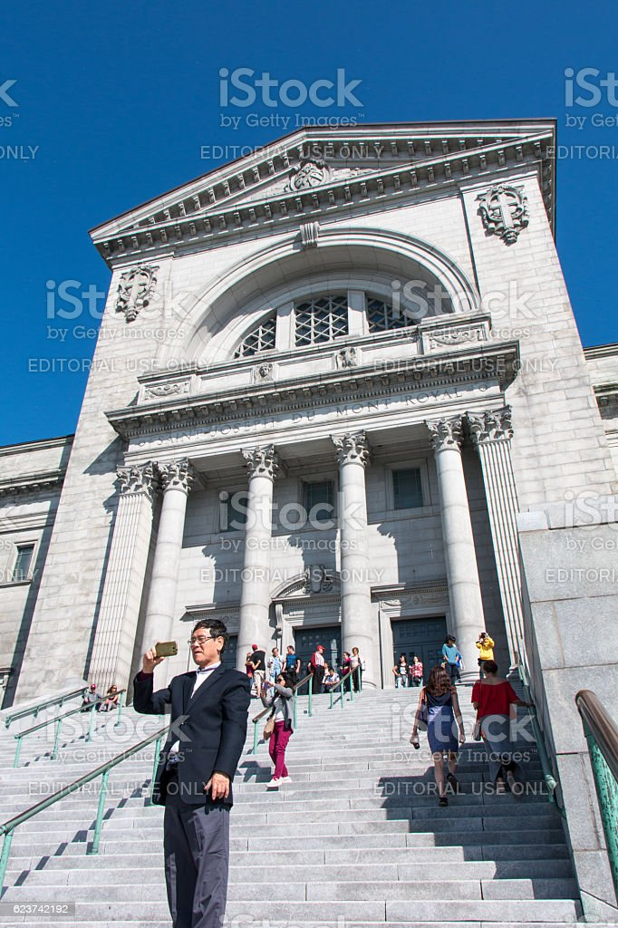 Tourists at Saint Joseph's Oratory of Mount Royal in summer stock photo