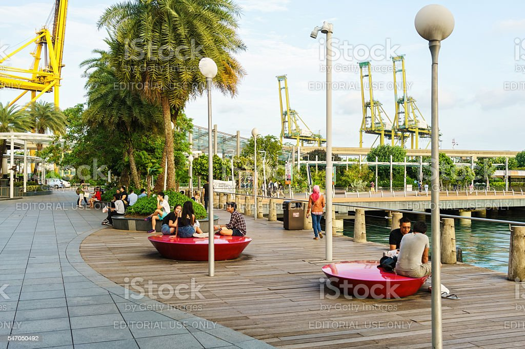 Tourists at Sentosa Boardwalk leading from Singapore Mainland stock photo