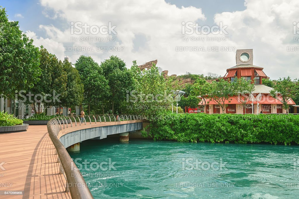 Tourists at Sentosa Boardwalk leading to Sentosa Island in Singapore stock photo