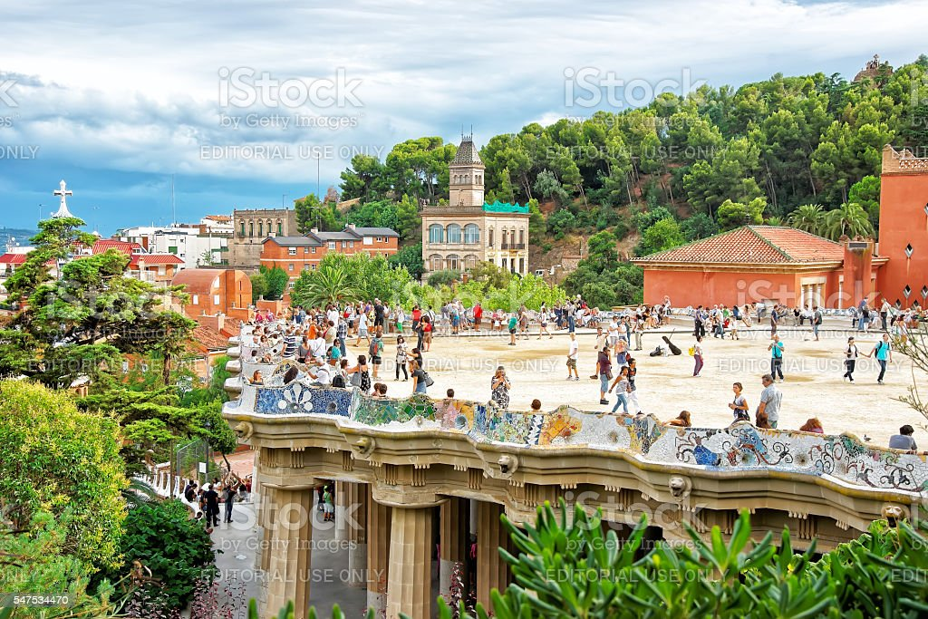 Tourists at Serpentine Bench in Park Guell in Barcelona stock photo
