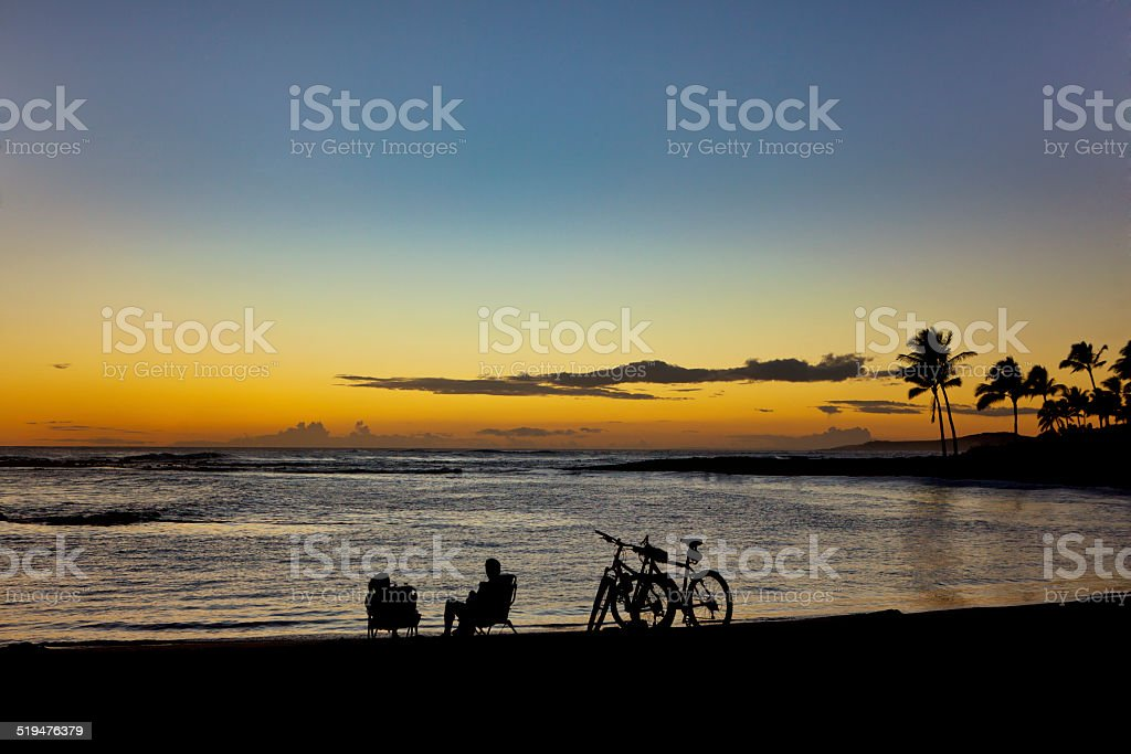 Tourists at Sunset on the Beach of Hawaii stock photo