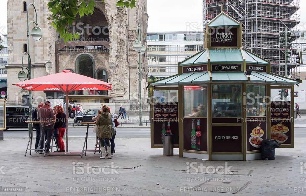 Tourists at takeaway in front of Gedaechtniskirche in Kudamm, Berlin stock photo