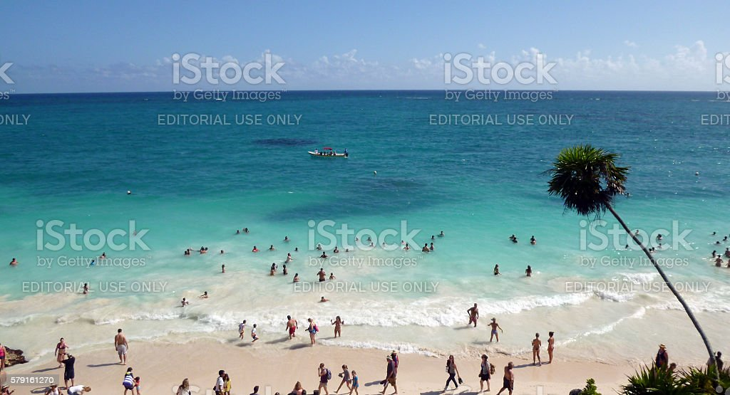 Tourists at the beach in ancient Mayan city of Tulum stock photo