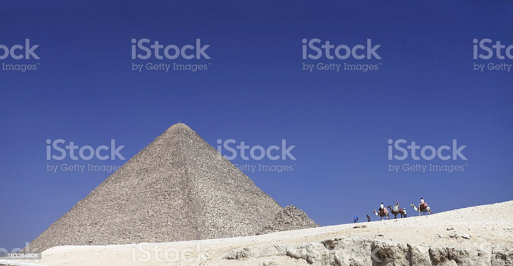 Tourists at the Cheops pyramid, Giza royalty-free stock photo