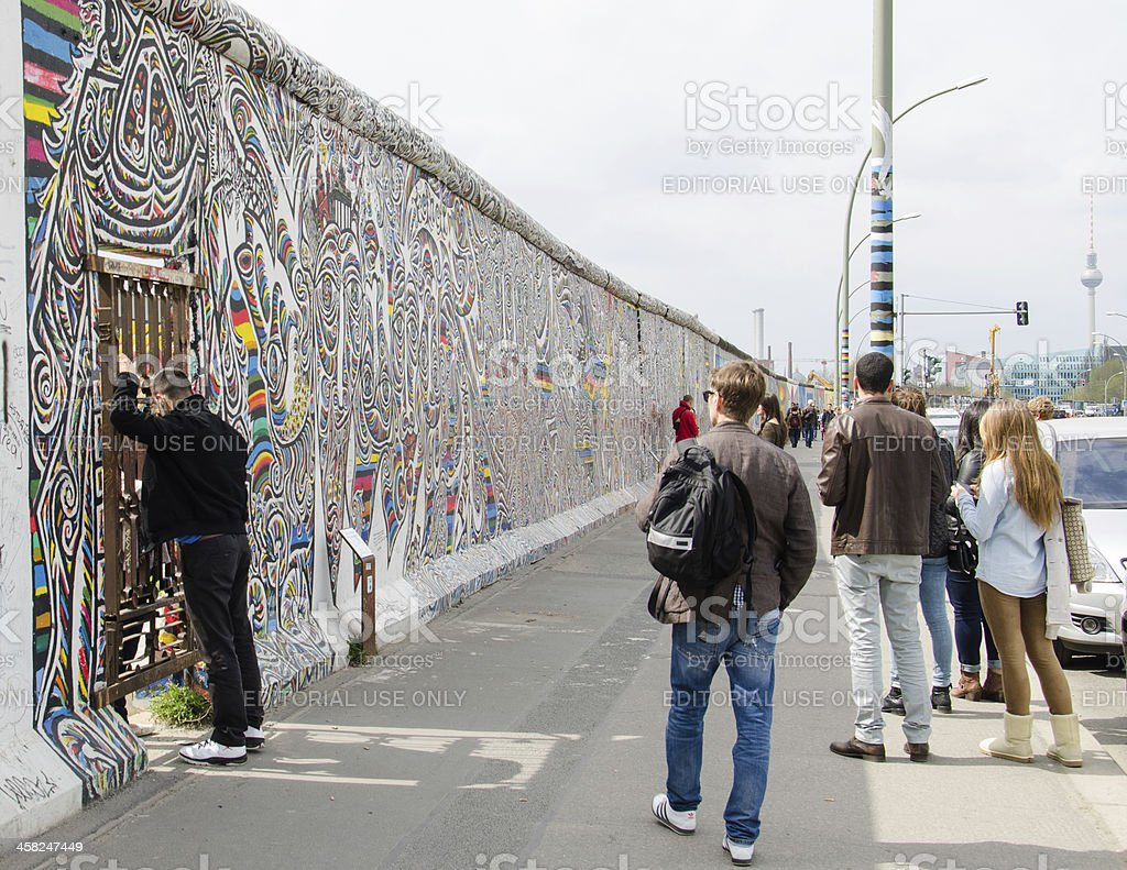 Tourists at the East Side Gallery in Berlin royalty-free stock photo