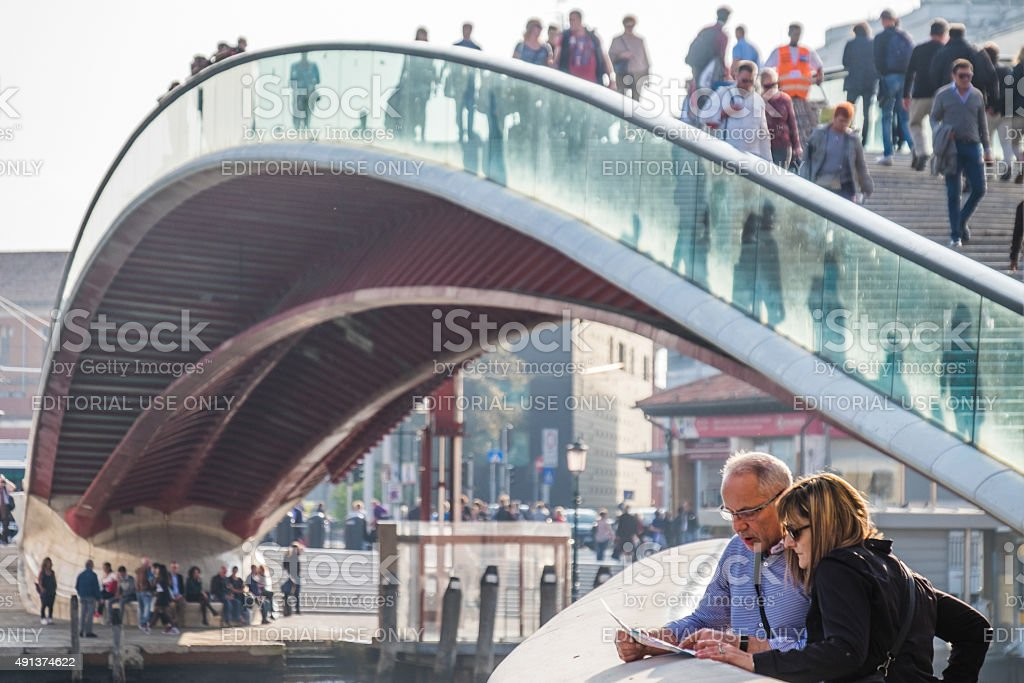 Tourists at the foot of the Calatrava Bridge, Venice stock photo