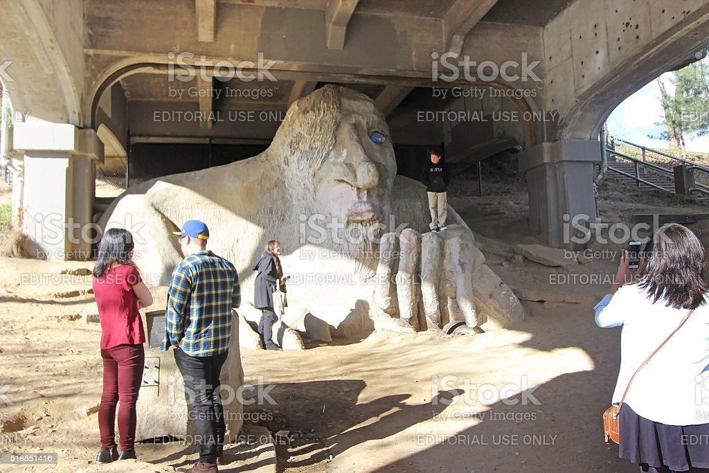 Tourists at the Fremont Troll - Seattle, Washington stock photo