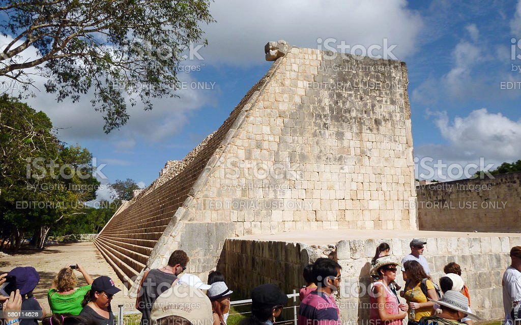 Tourists at the Great Ball Court in Chichen Itza stock photo