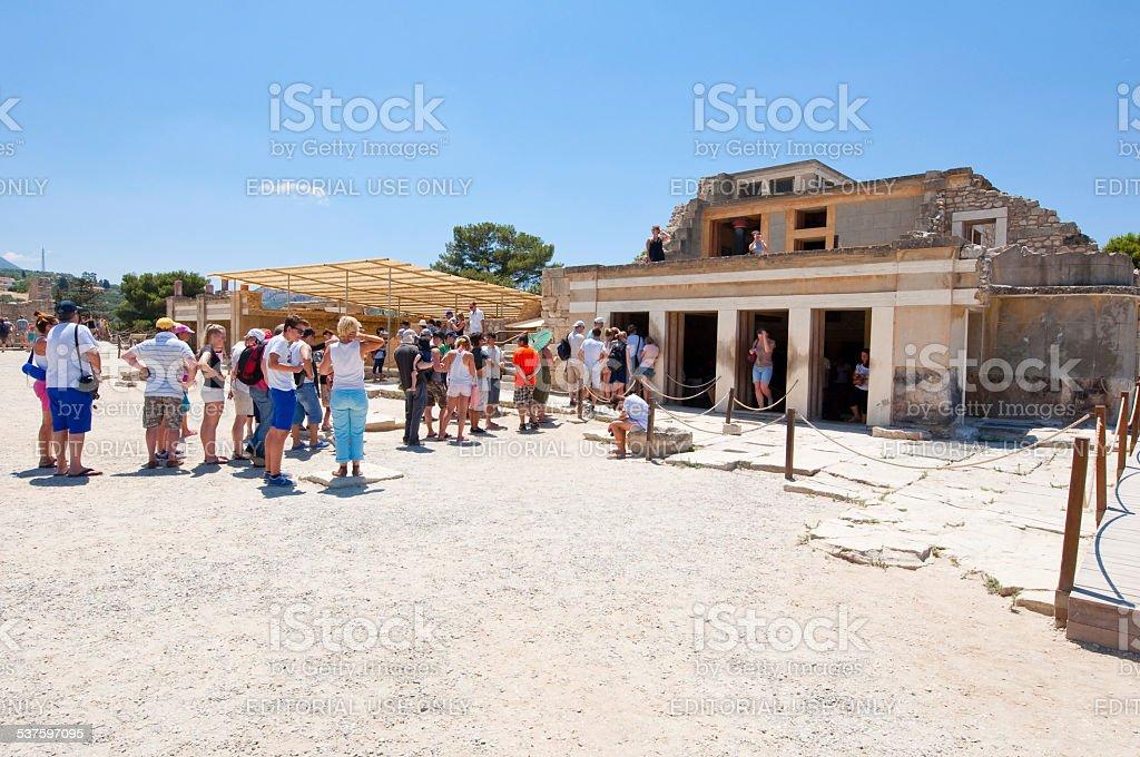 Tourists at the Knossos palace on Crete, Greece. stock photo