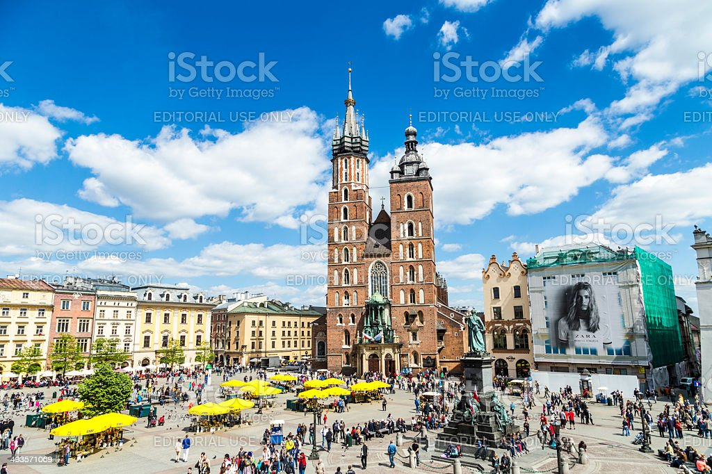 Tourists at the Market Square in Krakow stock photo