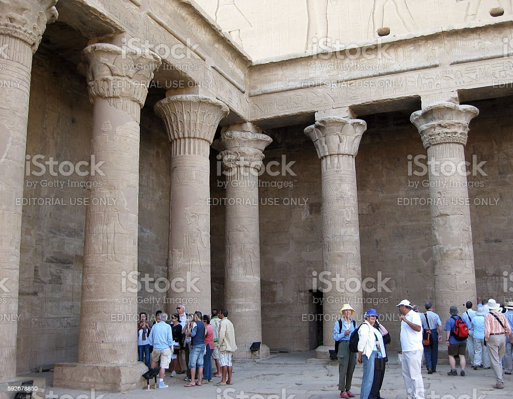 Tourists at the open courtyard of Edfu Temple in Egypt stock photo