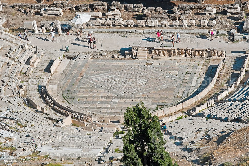 Tourists at the theater of Dionysus Eleuthereus stock photo