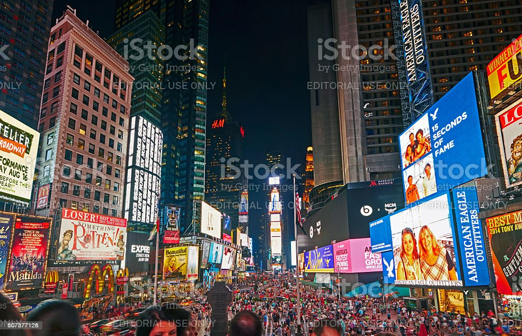 Tourists at Times Square at night stock photo
