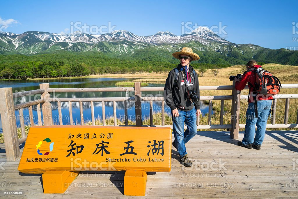 Tourists at viewing platform in front of the Lake Ichiko stock photo