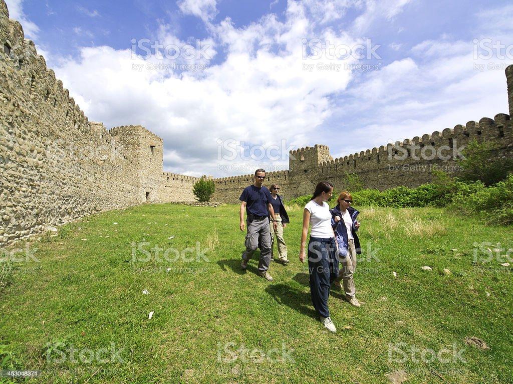 Tourists at wall stock photo