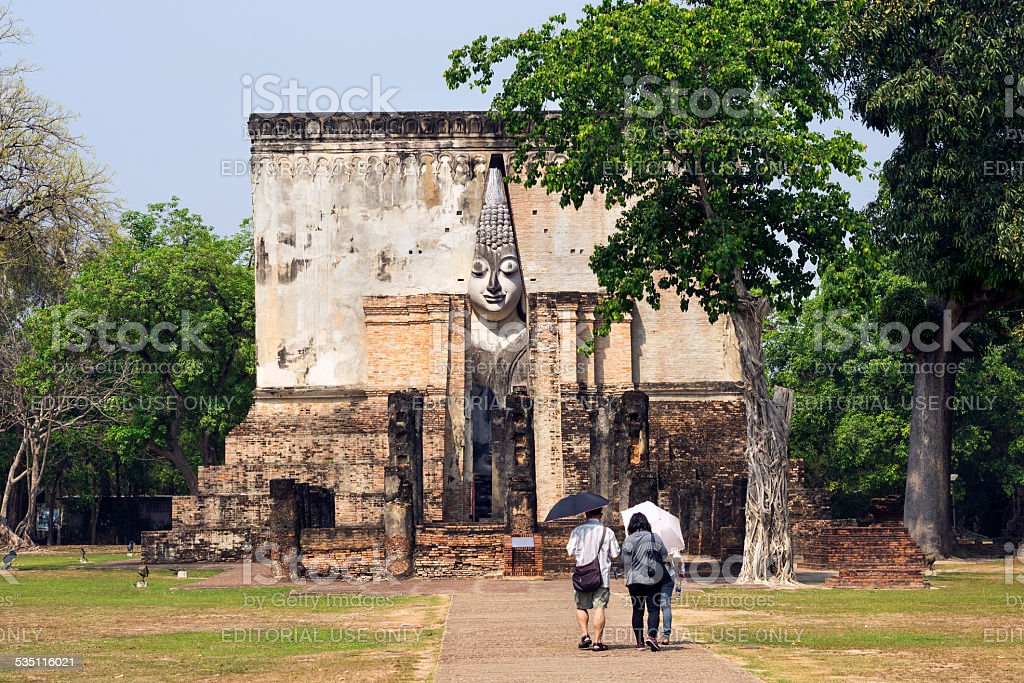 Tourists at Wat Si Chum Temple in Sukhothai, Thailand stock photo