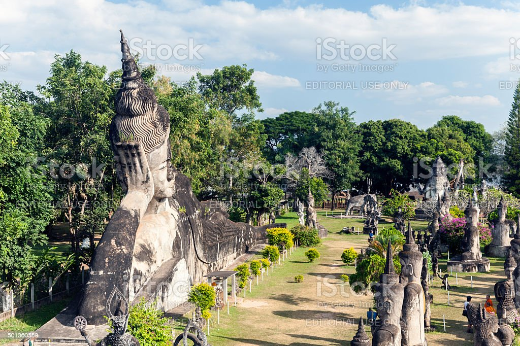 Tourists at Wat Xieng Khuan in Laos stock photo