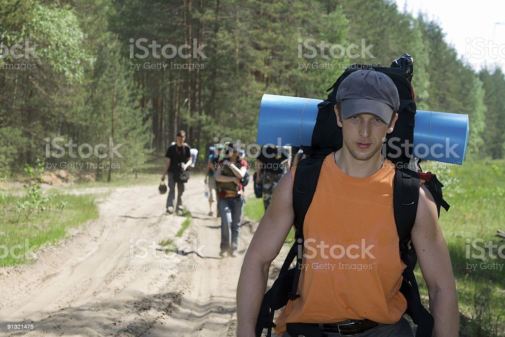 Tourists at wood royalty-free stock photo