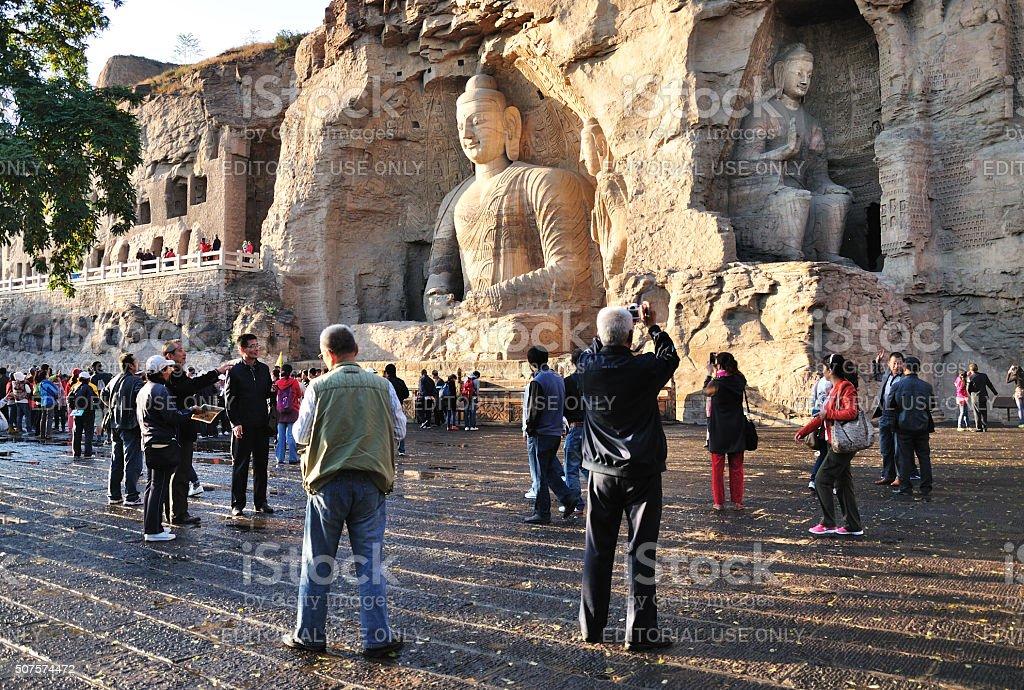 Tourists at Yungang Grottoes in Datong, Shanxi, China stock photo