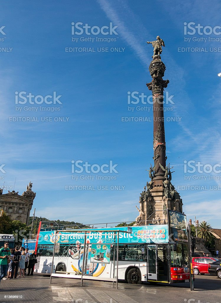 Tourists await tourist bus, under the statue of Christopher Columbus stock photo