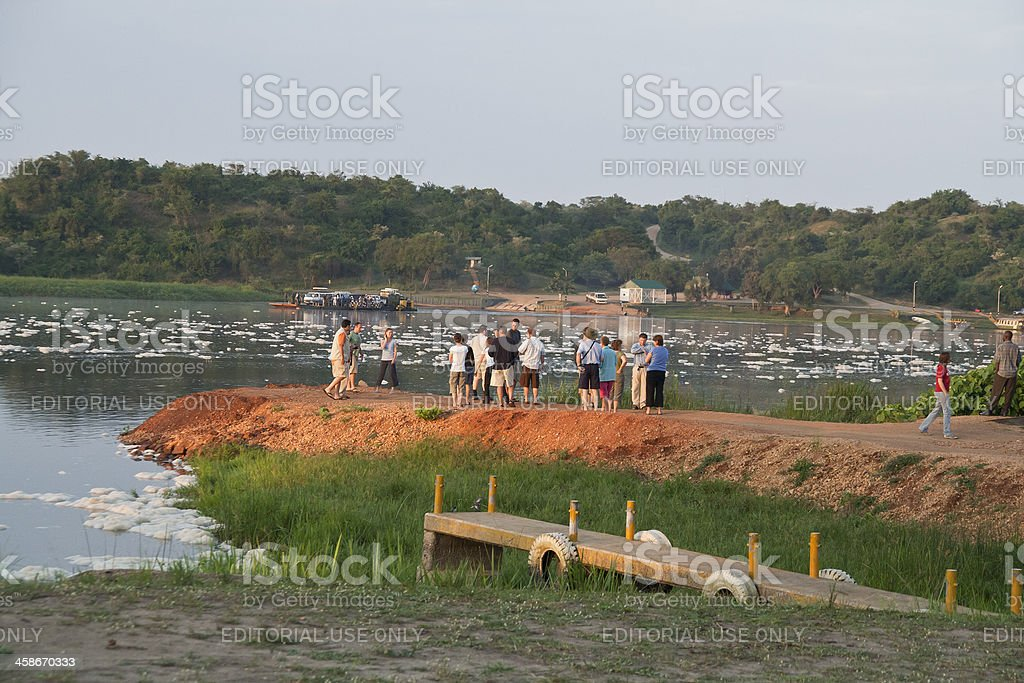 Tourists awaiting the Paraa Ferry; River Nile; Muchison Falls NP royalty-free stock photo