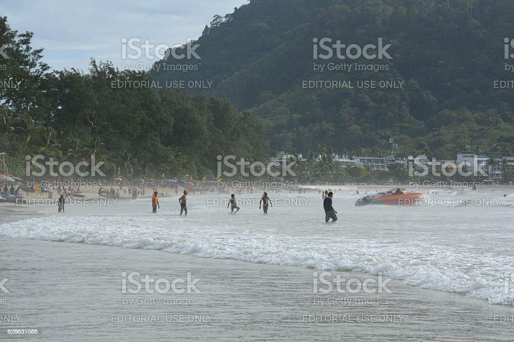 Tourists bathing on the Andaman sea at Patong beach, Phuket stock photo
