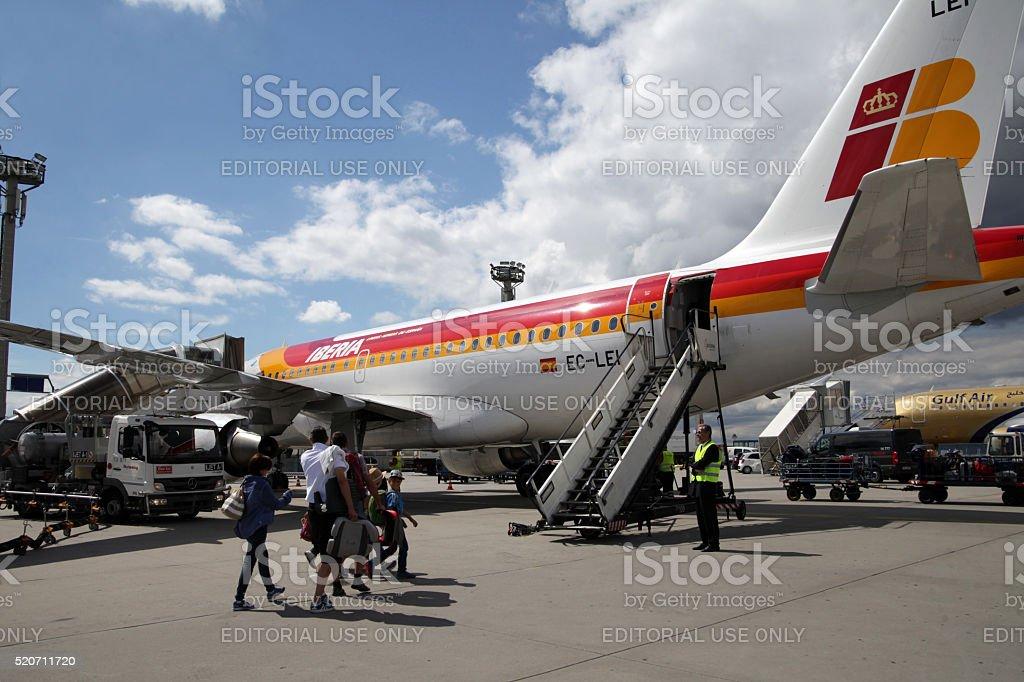 Tourists boarding Iberia Airbus A321 stock photo